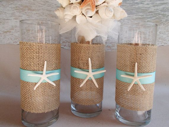 around the vases and tie it off with a simple blue ribbon and glue a seashell or small starfish to it for a beach themed or tropical bridal shower