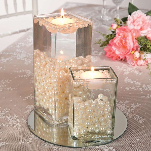 Wedding Centerpieces Without Flowers Arrangements Made Out Of Blush Pink Pearls And Candles Are Kind To Your Wallet Look Absolutely Breath Taking