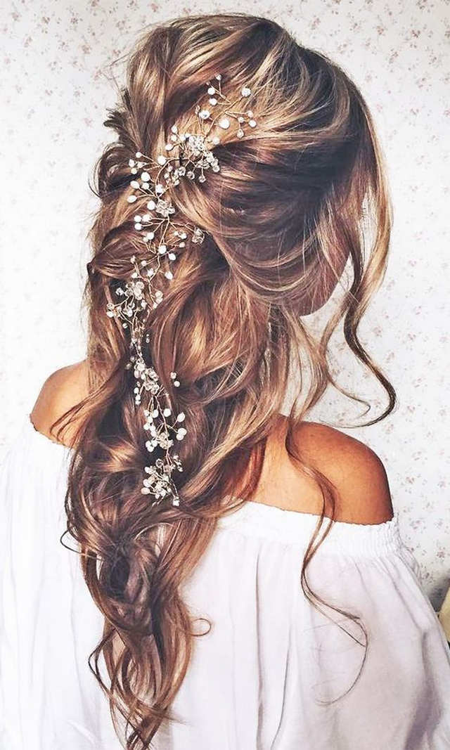 Best beach wedding hairstyles tips and ideas everafterguide pulled back with large hair accessory junglespirit Choice Image