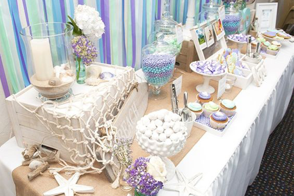 Easy and fun beach themed bridal shower ideas everafterguide back to the decoration want something cute here is one idea crepe paper in blue shades and white or purple and you can do a cool backdrop in a minute junglespirit Image collections