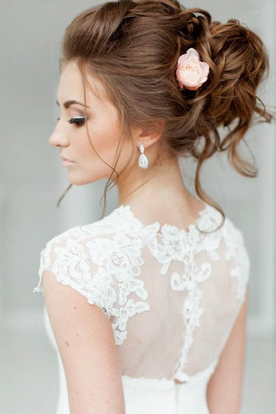 The 30 best wedding bun hairstyles everafterguide rose accented high low bun pmusecretfo Images